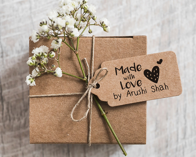 Personalised wooden text stamp with stamp pad made with love hearts thumb