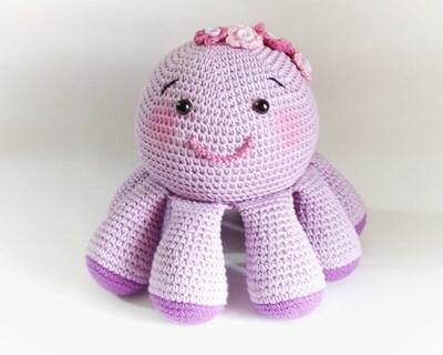 Crochet toy octopus thumb