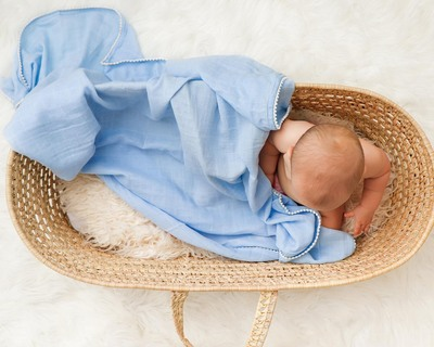 Blue pom pom swaddle thumb