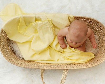 Yellow pom pom swaddle thumb
